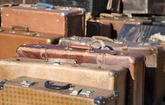 Row of old fashioned suitcases Stock Photos