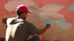 Artist on the mural job Stock Footage
