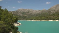 Blue lagoon in mountains - stock footage