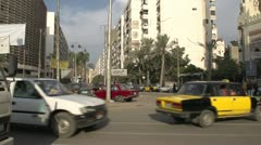 Street traffic in Alexandria, pan to mosque Stock Footage