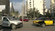 Stock Video Footage of street traffic in Alexandria, pan to mosque