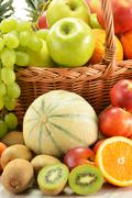 composition with assorted fruits in wicker basket - stock photo