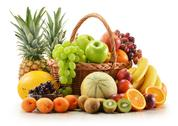 Stock Photo of composition with assorted fruits in wicker basket isolated on white
