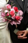 Stock Photo of wedding bouquet and hands