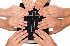 Stock Photo of holding holy bible