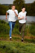 Stock Photo of young friends jogging