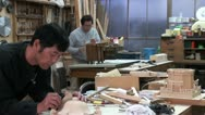 Stock Video Footage of Craftsmanship in Kyoto, Japan - making miniature temples in a workshop