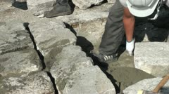 Laying heavy bricks on a road in Kyoto, Japan Stock Footage
