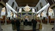 Believers pray afternoon prayer in Bushaief Synagogue Stock Footage