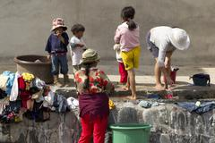 Ambato, Ecuador - 19 December 2011: Poor People Washing Their Clothing On The - stock photo