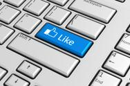 Social network concept: blue like button on keyboard Stock Illustration