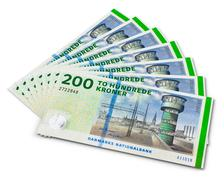 Stack of 200 Danish krone banknotes - stock photo