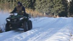 Bearded Man on ATV in Snowy Road Going By Fast Stock Footage