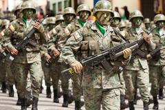 Stock Photo of Banos De Agua Santa, Ecuador - 20 December 2011: Troops Wearing War Equipment