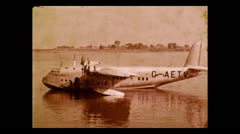 """Disembarking Imperial Airways flying boat """"Coriolanus"""" on the Nile 1937 Stock Footage"""
