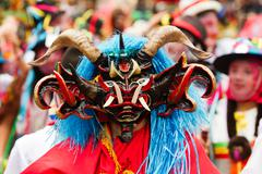 Stock Photo of Pillaro, Ecuador - 06 February 2012: People Disguised As Devils Dancing For The