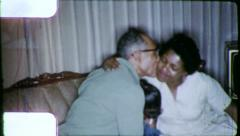 Stock Video Footage of FATHER DAUGHTER HUG KISS African American 1970 (Vintage Film Home Movie) 6261