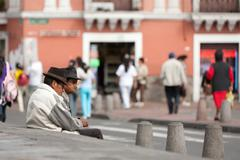 Stock Photo of Quito, Ecuador - 21 December 2011: Two Old Men Watching The People Passing By On
