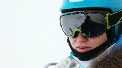 Woman skier in goggles goes up in chairlift to ski route Stock Footage