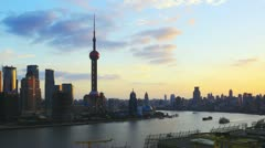 Panning time lapse of Shanghai from dusk to night - stock footage