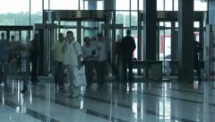 People in glass doors of modern business center timelapse Stock Footage