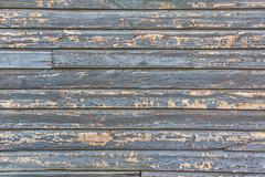 weathered clapboard barn siding backdrop or background - stock photo