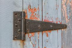 close up of antique barn hinge - stock photo