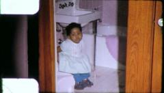 Black GIRL on TOILET Child African American 1970s Vintage Film Home Movie 6276 Stock Footage