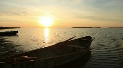 Wooden boat near the shore at dawn - stock footage