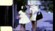 Stock Video Footage of MOTHER DAUGHTER Sunday Best African American 1970 (Vintage Film Home Movie) 6283