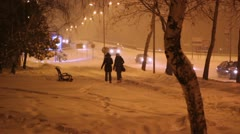Walking on Snowy City Streets at Night Stock Footage