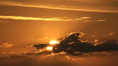 Golden sunrise behind clouds Stock Footage