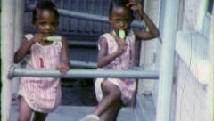 GIRLS TWINS POPSICLE Black African American 1960s Vintage Film Home Movie 6298 Stock Footage