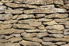 dry stone wall - stock photo