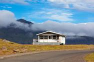Stock Photo of white house and asphalt road in east iceland