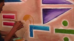 Wall painter draws 2 Stock Footage