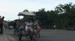 Havana, Tricycles passing by Stock Footage