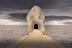 Fantasy rock house in ocean Stock Photos