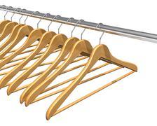 Coat hangers on clothes rail Stock Illustration