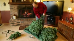 Setting up the Christmas tree fireplace Stock Footage