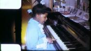 Black GIRL PLAYING PIANO African American 1970s Vintage Film Home Movie 6305 Stock Footage