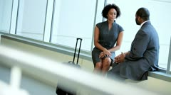 African American Colleagues Meeting Airport Lounge - stock footage