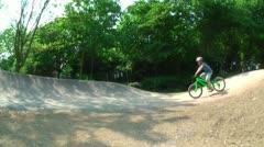 BMX Kids SideCam PumpTrack summer Stock Footage