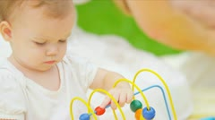 Close up of Caucasian baby playing with toy in garden - stock footage
