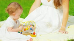 Caucasian mother playing together little toddler in park - stock footage