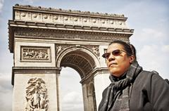Girl In Wheelchair At Arch De Triomphe - stock photo