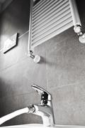 faucet with water and heater - stock photo