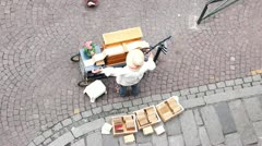 Unidentified musician with on a barrel organ (hurdy-gurdy). France - stock footage