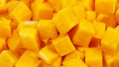 Pumpkin cutted in small square blocks Stock Photos