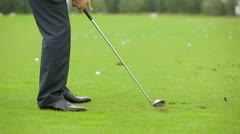 Man in a business suit playing golf Stock Footage